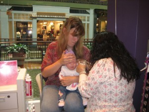 Evie's first ear is being pierced.