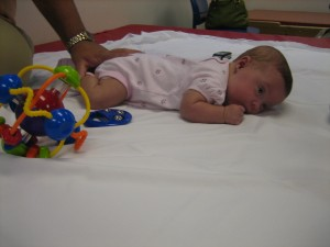 Maggie doing that stinkin' tummy time....It's hard work!