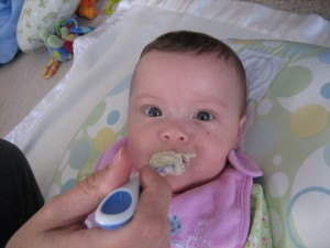 Maggie tasting her first spoonful of oatmeal!