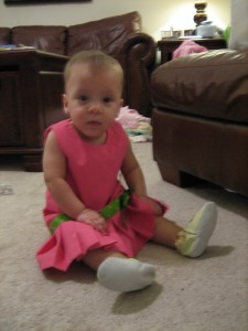 Evie loves her new Robeez!  I love the dress!!