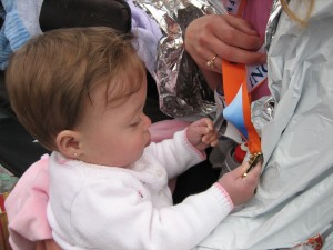 Maggie is admiring my finisher's medal!