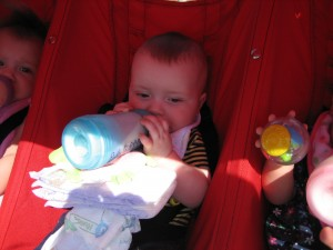 Josh is working hard to hold his own bottle.