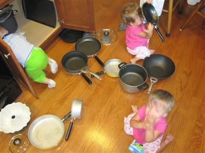 Josh is clearing out all the pots and pans for the girls to play with!