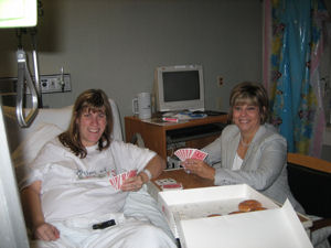 Mom and I enjoying a game of cards....and doughnuts!
